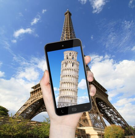 pise: Hand taking a picture with mobile phone of the eiffel tower with Pise tower on the screen