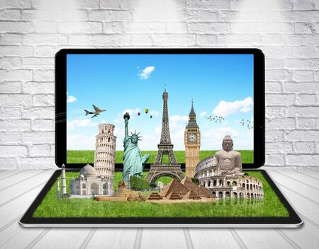 world travel: Famous monuments of the world grouped together on a digital tablet