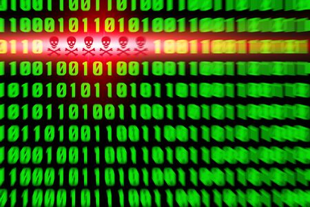 Red virus alert in a green binary code Stock Photo