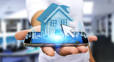 buying a house: Businessman using mobile phone with digital house and city