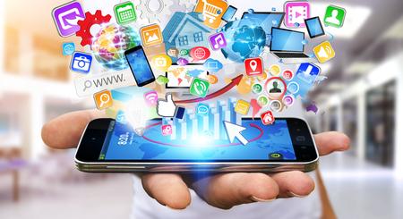 Hombre de negocios con teléfono móvil moderno en la mano y aplicaciones sobrevolando Foto de archivo - 44832549