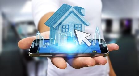 smart investing: Businessman using mobile phone with digital house and city