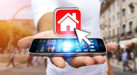 bienes raices: Hombre de negocios con teléfono móvil moderno en la mano usando la aplicación de viaje