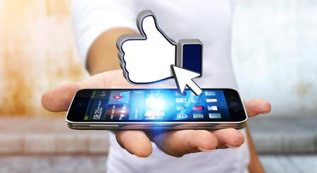 社会のネットワークが好き彼の手で、現代の携帯電話を持ったビジネスマン