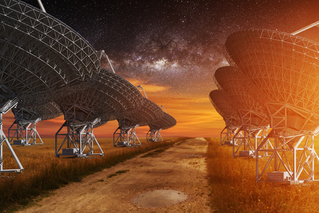 astrophysics: Radio Telescope view at night with milky way in the sky