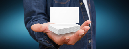 identity card: Businessman holding white business card in his hand