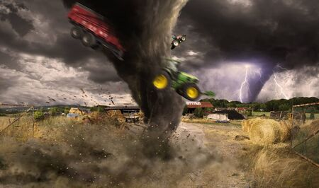 tornado: View of a large tornado destroying a barn