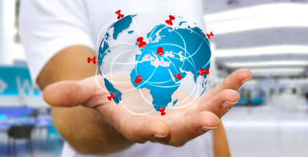 world travel: Businessman with digital world map and pins floating over his hand Stock Photo