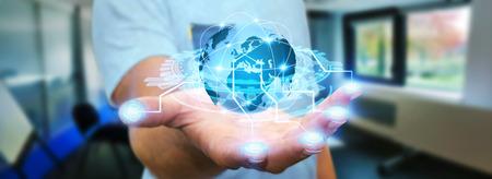 L'homme tenant le monde numérique connecté à ses doigts