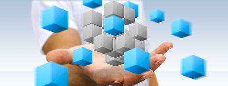 Empresario sosteniendo el cubo digital en sus manos