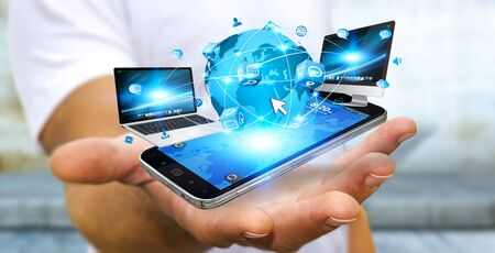multimedia: Businessman holding multimedia tech devices in his hand