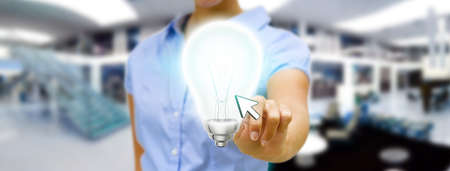 creativity and innovation: Young woman holding shinny lightbulb in his hand
