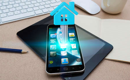 smart investing: Modern mobile phone in office with real estate application