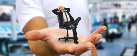 daydream: Man holding a businessman in his hand having a break