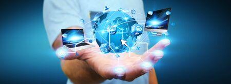 Hombre que sostiene el mundo digital conectado a los dedos