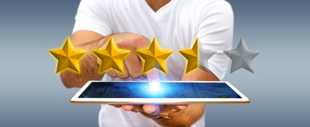 ranking: Young businessman ranking using digital stars and tablet Stock Photo