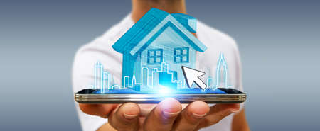 business project: Businessman using mobile phone with digital house and city flying over Stock Photo