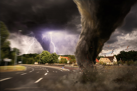 windstorm: View of a large tornado destroying an entire city
