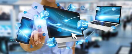 mobile internet: Businesswoman connecting tech devices computer phone and tablet Stock Photo