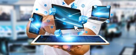 computer tech: Businessman connecting tech devices computer phone and tablet