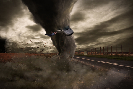 tempest: View of a large tornado destroying a road