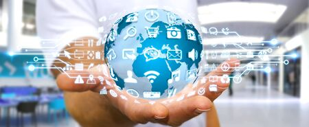 connexion: Businessman holding digital web earth with modern icons Stock Photo