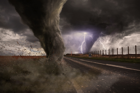 View of a large tornado destroying a road