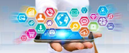 tactile: Businessman using digital tactile screen with his mobile phone