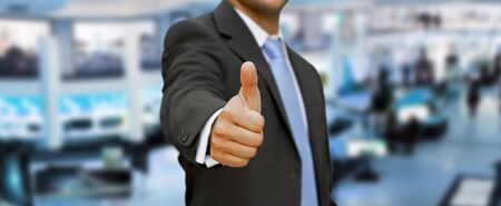thump: Businessman at the office with his thumb up