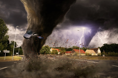 View of a large tornado destroying an entire city