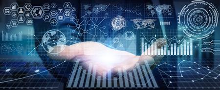 Homme d'affaires en utilisant des écrans futuristes avec des graphiques et des graphiques Banque d'images