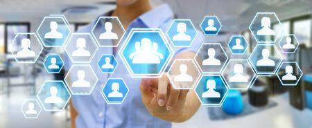 connexion: Businesswoman using digital social network interface