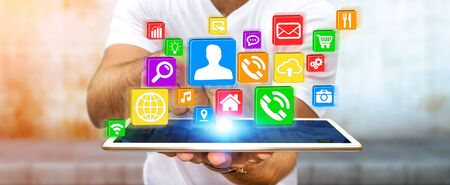 connexion: Young businessman holding modern digital icon application over his tablet Stock Photo