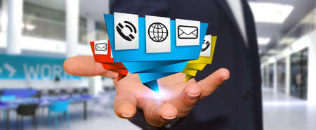 connexion: Young businessman holding modern digital origami icon application in his hand