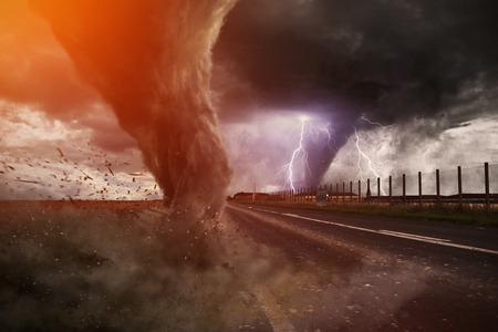 tornado wind: View of a large tornado destroying a road