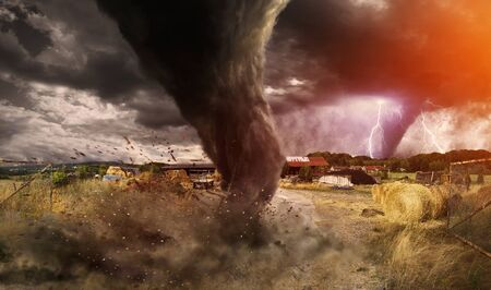 windstorm: View of a large tornado destroying a barn