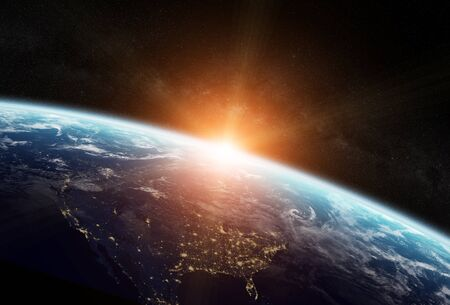 earth from space: View of the planet Earth from space during a sunrise