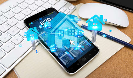 smart investing: Blue house and keys connected to each other over mobile phone