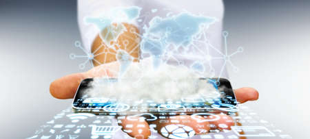 hoard: World over a cloud with connections and modern icons in businessman hand Stock Photo