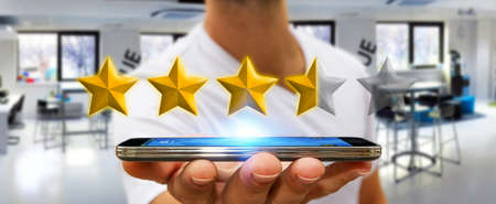 scoring: Young businessman ranking using digital stars and mobile phone