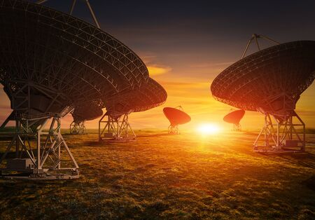 astrophysics: Satellite dish view during colorful sunset