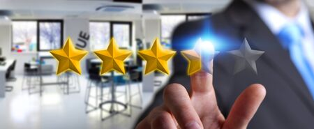 ranking: Young businessman ranking with his hand using digital stars