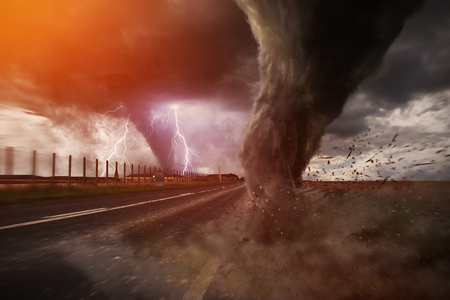 windstorm: View of a large tornado destroying a road