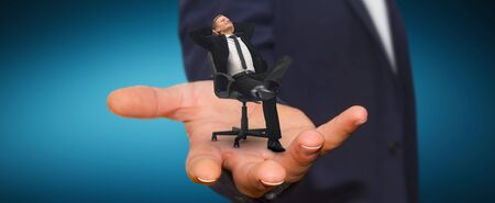 having a break: Man holding a businessman in his hand having a break