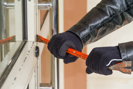 crowbar: Burglar trying to break into a house with a crowbar