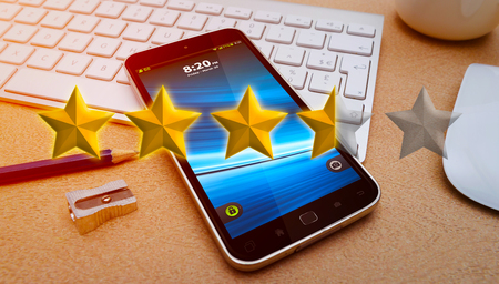 five star: Five star raking over modern mobile phone in office