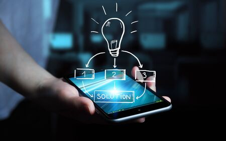 Businessman holding hand drawn lightbulb over his mobile phone Stock Photo