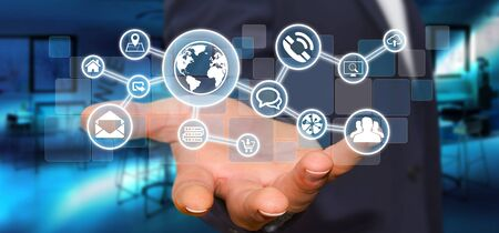 connexion: Businessman in his office holding a digital tactile screen web network with web icons Stock Photo