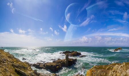 Distant planet system view from cliffs and ocean Stock Photo