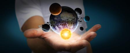 jupiter light: Solar system flying over businessman hand on dark office background